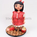 standing girl gravity defying cake